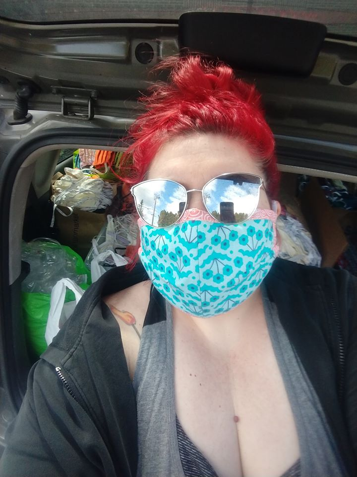 Founder Candace Frank with a car full of masks